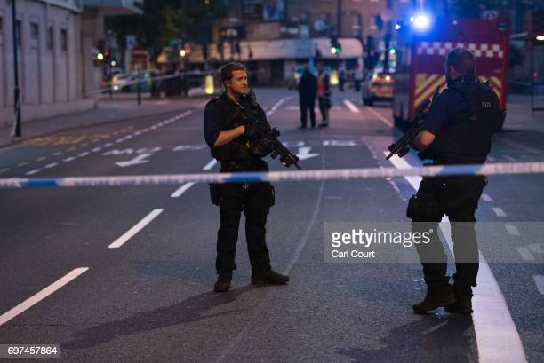 Armed police officers guard a road leading to Finsbury Park Mosque after an incident in which a van hit worshippers outside the building on June 19...