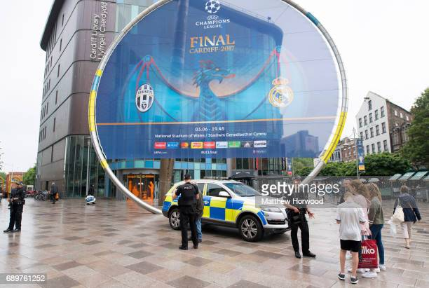 Armed police officers in Cardiff city centre on May 29 2017 in Cardiff Wales Preparations are underway for the UEFA Champions League final which will...