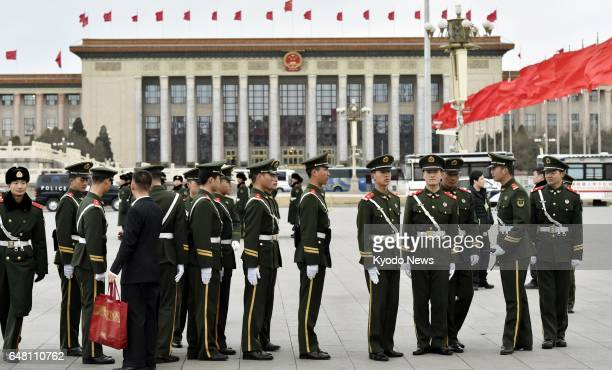 Armed police officers keep guard on March 5 around Beijing's Great Hall of the People where the National People's Congress started ==Kyodo