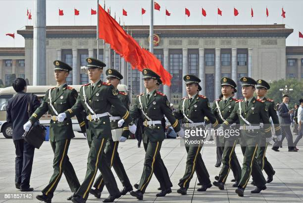 Armed police officers march through Tiananmen Square in Beijing on Oct 16 two days before the Communist Party's 19th National Congress opens ==Kyodo