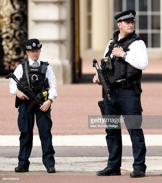 Armed police officers on duty outside Buckingham Palace during The Colonel's Review on June 10 2017 in London England The Colonel's Review is the...