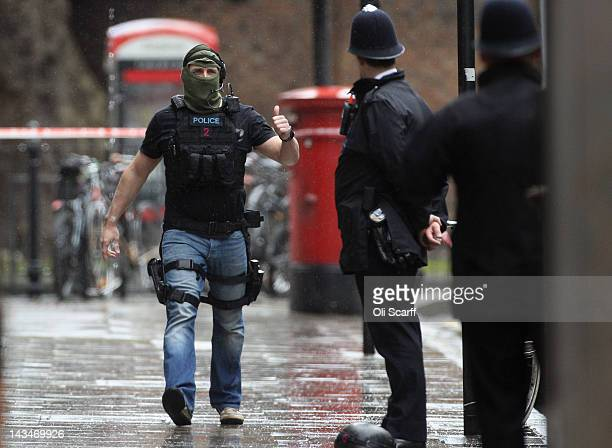 Armed police officers on the scene where a man threaten to blow himself up in an office building on Tottenham Court Road on April 27 2012 in London...