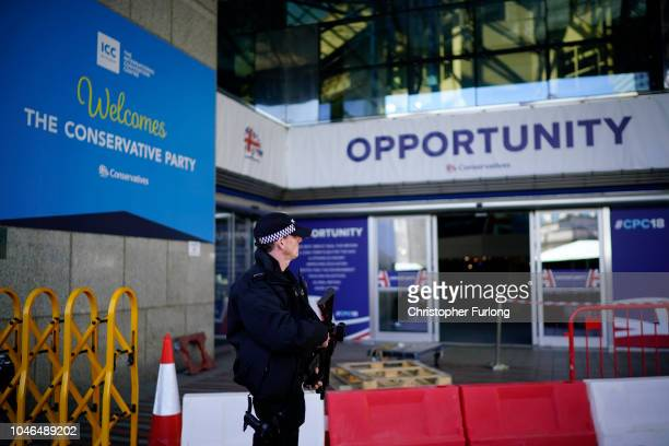 Armed police officers patrol and keep watch as politicians and delegates begin to arrive for the annual Conservative party conference at the...