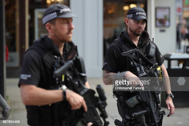 Armed police officers patrol around St Ann's Square during a vigil on May 24 2017 in Manchester England An explosion at Manchester Arena on the night...