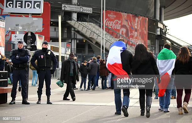Armed police officers patrol around the outside perimeter of the stadium before the RBS Six Nations match between France and Italy at the Stade de...