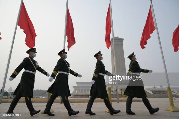 Armed police officers patrol at Tiananmen Square during the opening meeting of the fourth session of the 13th National People's Congress on March 5,...
