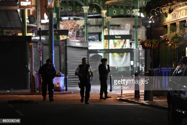 Armed police officers patrol in Borough Market on June 4 2017 in London England Police responded to what they are calling terrorist attacks on London...