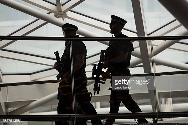 Armed police officers patrol King's Cross station on August 4 2016 in London England Six people were attacked by a 19 year old man with a knife at...