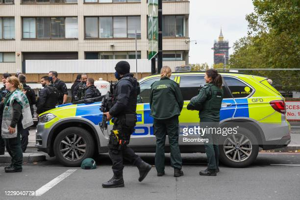Armed police officers patrol near St. Thomas' Hospital in London, U.K., on Tuesday, Oct. 13, 2020. Lambeth Police says there are dealing with a...