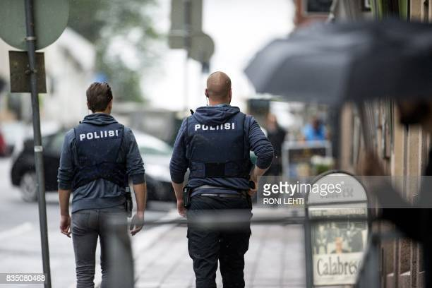 Armed police officers patrol near the Turku Market Square in the Finnish city of Turku where several people were stabbed on August 18, 2017. One...