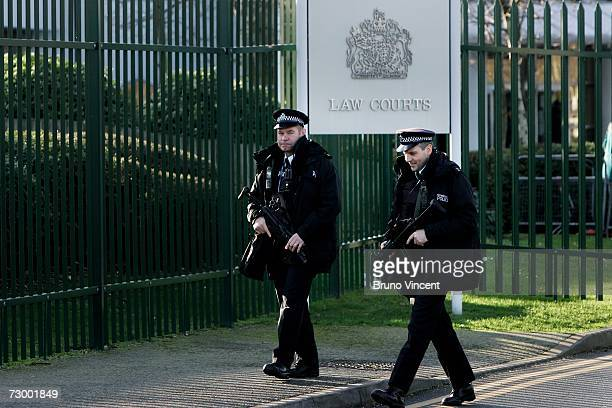 Armed police officers patrol near Woolwich Crown Court during the trial of suspects involved in the failed bombings of the London transport network...