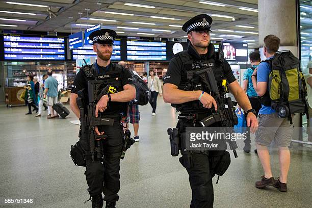 Armed police officers patrol St Pancras station on August 4 2016 in London England Six people were attacked by a 19 year old man with a knife at...