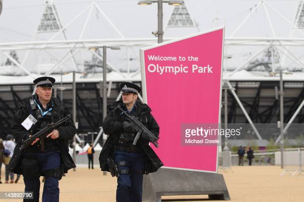 Armed police officers patrol the Olympic Park during day two of the BUCS VISA Athletics Championships 2012 LOCOG Test Event for London 2012 at the...