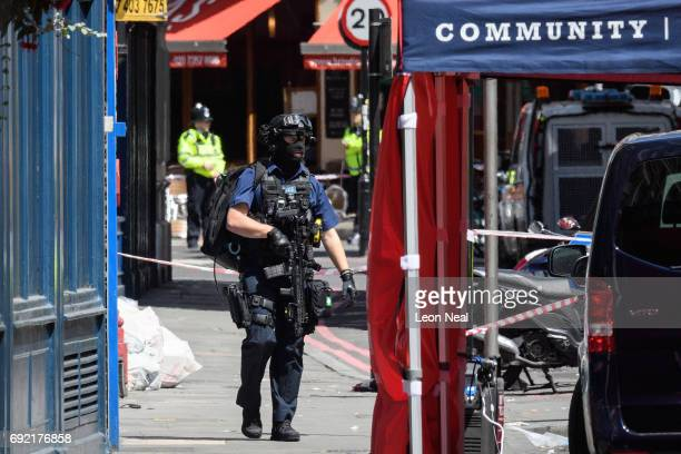 Armed police officers return to their vehicles following last night's London terror attack on June 4 2017 in London England Prime Minister Theresa...
