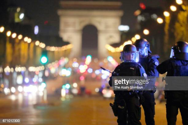 Armed police officers secure the area after a gunman opened fire on the Champs Elysees on April 20 2017 in Paris France One police officer was...