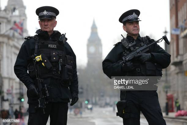Armed police officers secure the area near the Houses of Parliament in central London on March 23 2017 the day after the March 22 terror attack in...