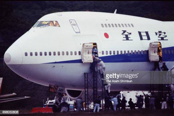 Armed police officers smash into the hijacked ANA 857 at Hakodate airport on June 22, 1995 in Hakodate, Hokkaido, Japan.