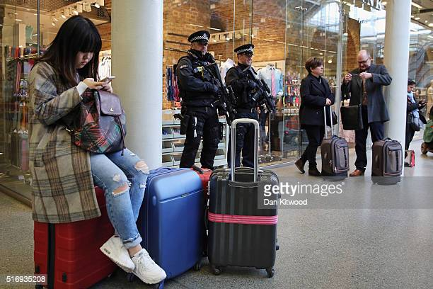 Armed Police Officers stand at the entrance to the Eurostar at St Pancras Station on March 22 2016 in London England Journeys to Brussels were...