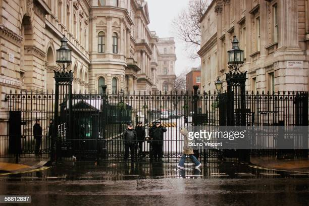 Armed Police officers stand guard at the gates of Downing Street on January 18, 2005 in London, England. Police have investigated a plot to kidnap...
