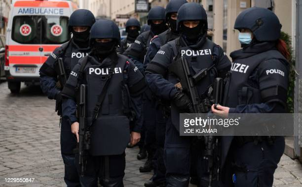Armed police officers stand guard before the arrival of Austrian Chancellor Kurz and President of the European Council to pay respects to the victims...