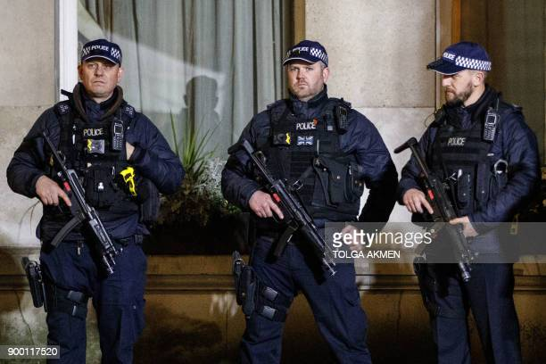 Armed police officers stand guard in Westminster ahead of the New Year's celebrations in central London on December 31 2017 / AFP PHOTO / Tolga Akmen