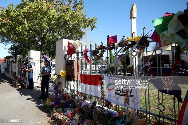Armed police officers stand guard outside the Al Noor mosque during Friday prayers in Christchurch on May 3 ahead of the holy month of Ramadan The...