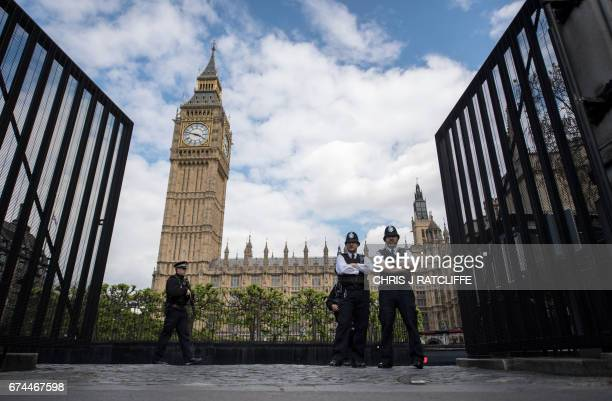 Armed police officers stand guard outside the Houses of Parliament in London on April 28, 2017. British police said April 28 they had arrested six...