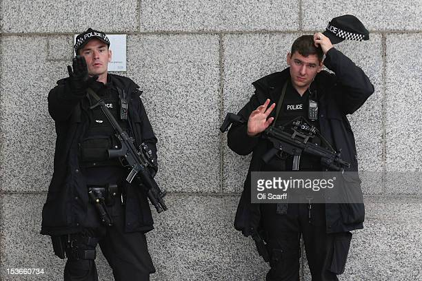 Armed police officers stand guard outside the International Convention Centre which is hosting the Conservative party conference on October 8 2012 in...