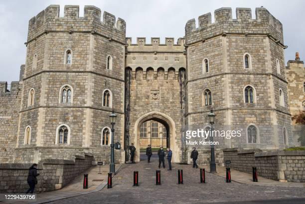 Armed police officers stand guard outside the King Henry VIII gate at Windsor Castle on 3 November 2020 in Windsor, United Kingdom. The UK terrorism...