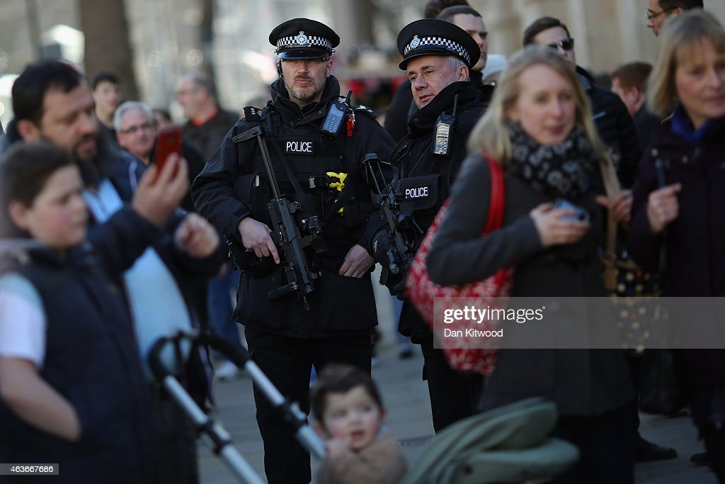 Armed Police Officers stand on Whitehall on February 17, 2015 in London, England.