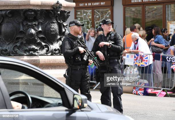 Armed police officers watch over crowds on May 18 2018 in Windsor England The Berkshire town west of London will host the wedding of Prince Harry to...