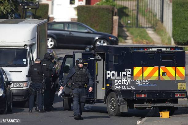 Armed police officers work at the scene of a residential address in northwest London on October 23 2016 where police are responding to a report that...