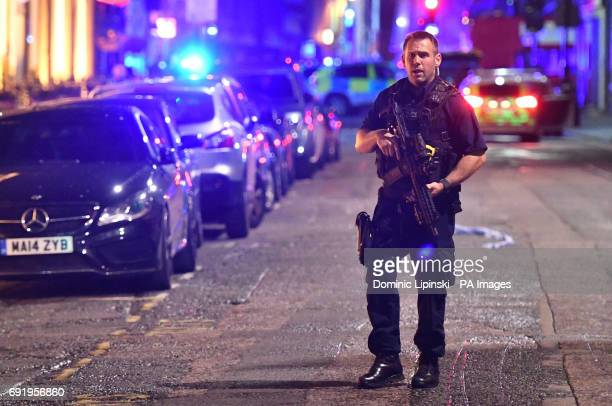 Armed police on Borough High Street as police are dealing with a quotmajor incidentquot at London Bridge