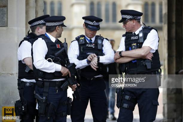 Armed police on duty in Windsor on May 18 the eve of Britain's Prince Harry's royal wedding to US actress Meghan Markle Britain's Prince Harry and US...