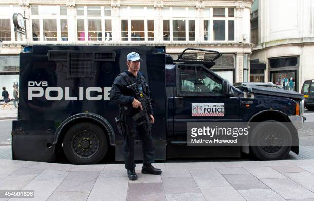 Armed police on High Street in Cardiff as preparations continue ahead of the 2014 Nato summit on September 2 2014 which is being held in Newport...