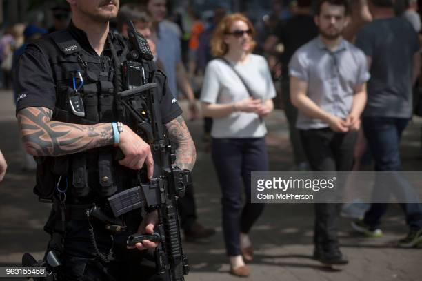 Armed police on patrol in St. Ann's Square, Manchester after the holding of a minute's silence in memory of the bomb attack the previous Monday at...