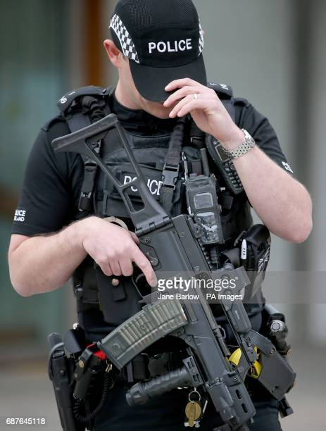 Armed police on patrol outside the Scottish Parliament building in Holyrood Edinburgh after Scotland Yard announced armed troops will be deployed to...