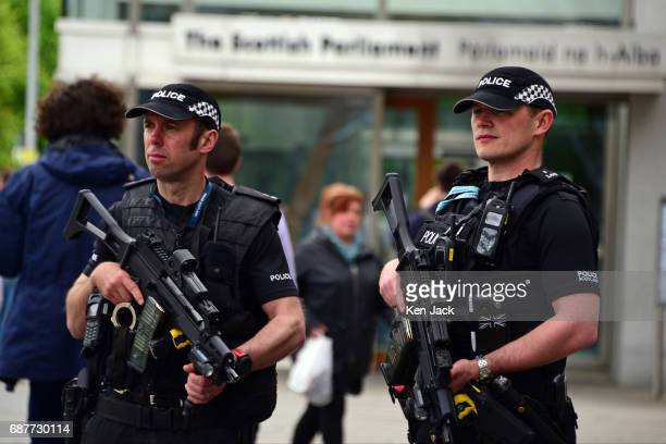 Armed police on patrol outside the Scottish Parliament on May 24 2017 in Edinburgh United Kingdom Heightened security has been put in place...