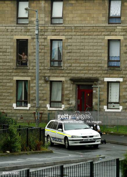 Armed police outside a flat in Glasgow's Balintore Street following an incident just before midnight at the nearby Shettleston police station where a...