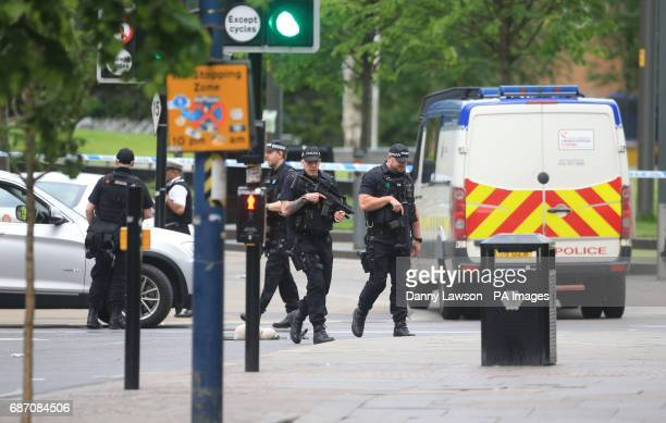 Armed police outside the National Football Museum close to the Manchester Arena the morning after a suicide bomber killed 22 people including...