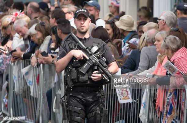 Armed police patrol ahead of the wedding of Prince Harry and Meghan Markle on May 18 2018 in Windsor England The Berkshire town west of London will...