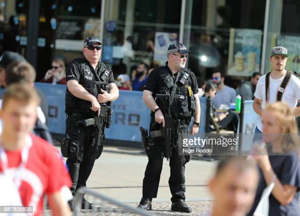 Armed police patrol as Kell Brook takes part in a public workout at the Peace Gardens on May 24 2017 in Sheffield England Brook fights American Errol...