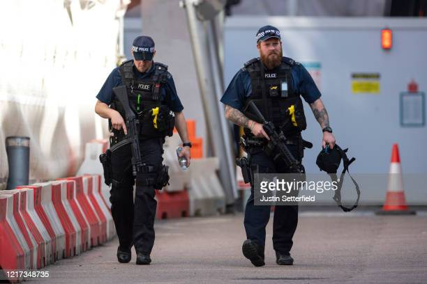 Armed police patrol at St Thomas' Hospital on April 07, 2020 in London, England. Prime Minister Boris Johnson was transferred to the intensive care...