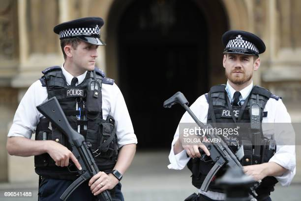 Armed police patrol by the Houses of Parliament on June 16 2017 London police today arrested a man at the fence surrounding the British parliament on...