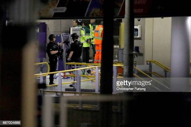 Armed police patrol inside Victoria Station adjacent to Manchester Arena on May 23 2017 in Manchester England An explosion occurred at Manchester...