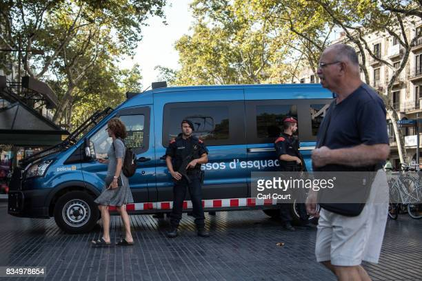 Armed police patrol Las Ramblas following yesterday's terrorist attack on August 18 2017 in Barcelona Spain Fourteen people were killed and dozens...