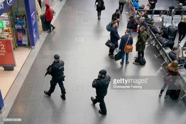 Armed police patrol Manchester's Piccadilly Station during heightened security after the stabbing on Monday at nearby at Victoria Station on January...