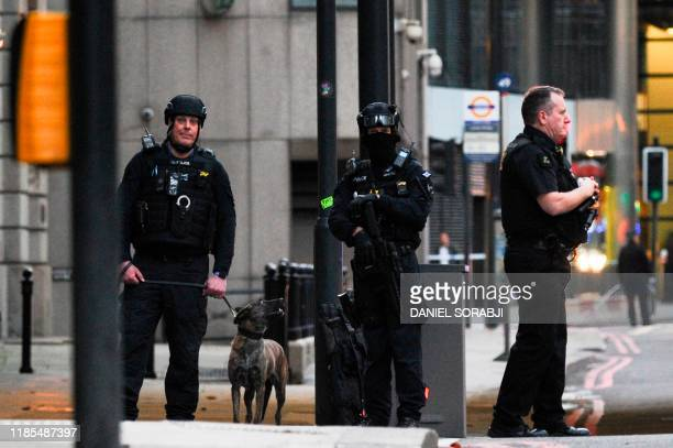 Armed police patrol near London Bridge in central London on November 29 2019 after reports of shots being fired on London Bridge The Metropolitan...