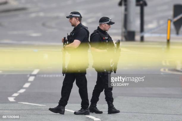 Armed police patrol near Manchester Arena following a deadly terror attack in Manchester northwest England on May 23 2017 Twenty two people have been...
