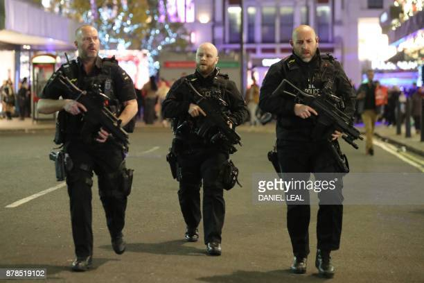 TOPSHOT Armed police patrol near Oxford street as they respond to an incident in central London on November 24 2017 British police said they were...